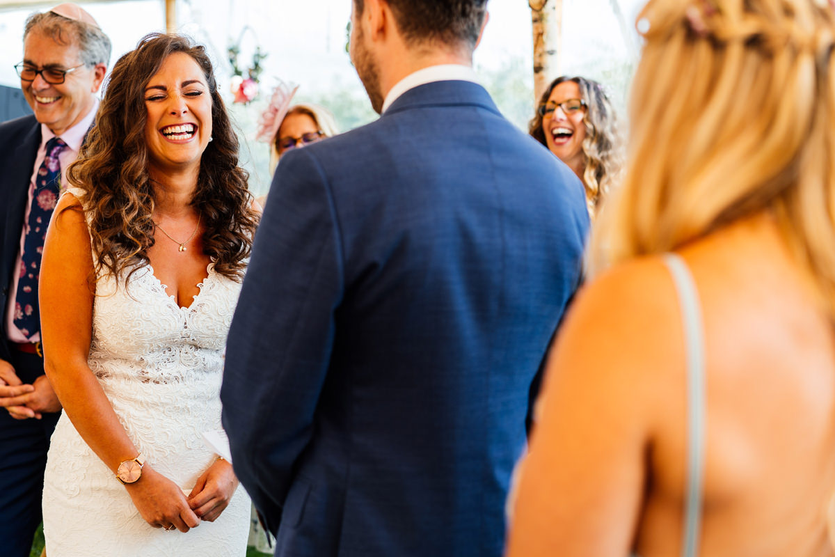 bride smiling during the ceremony