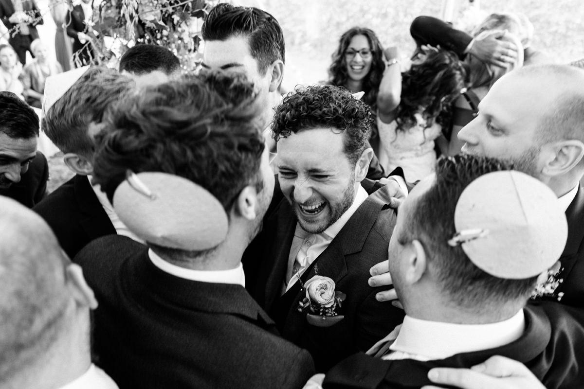 groom celebrates with his groomsmen