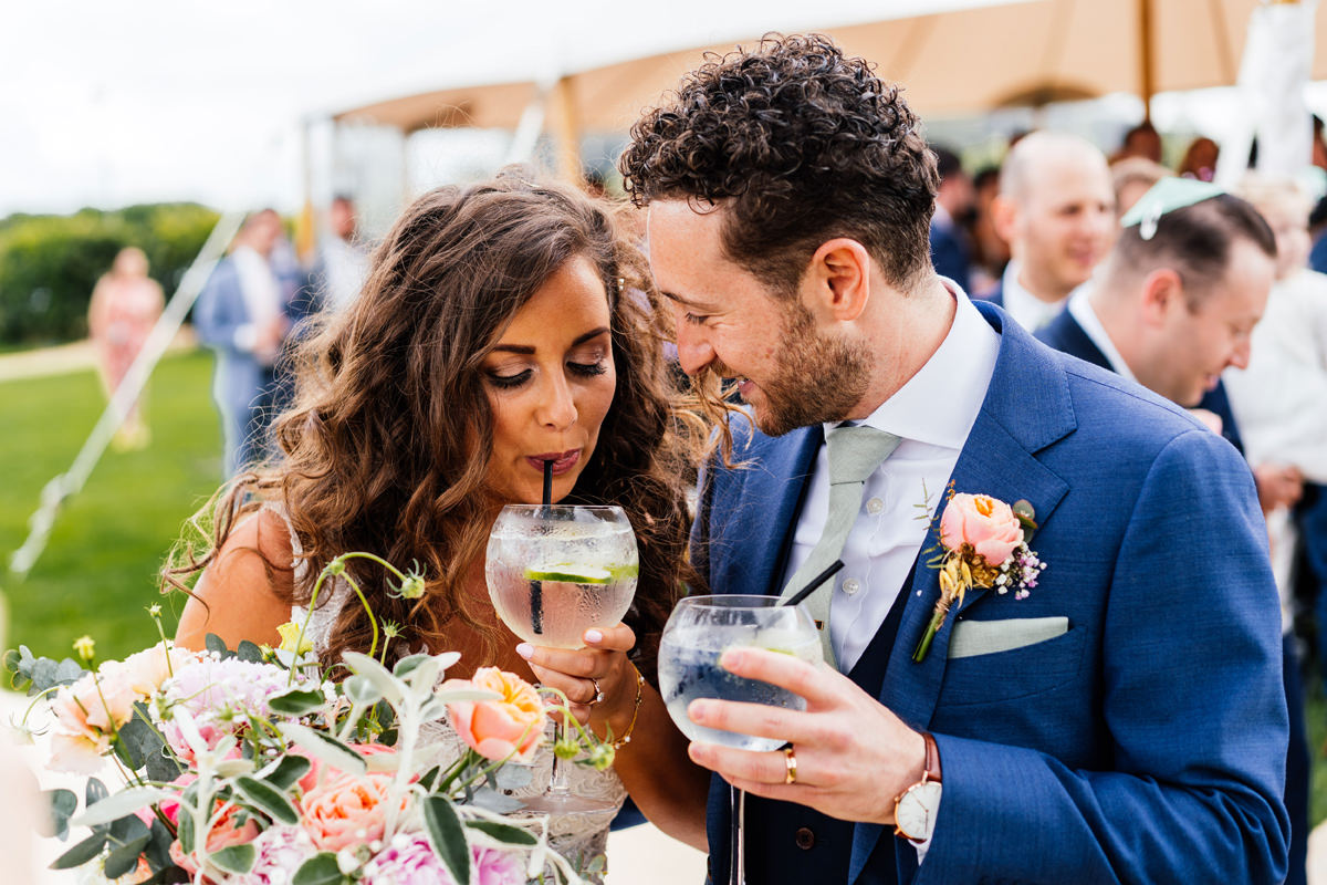 bride and groom have a drink straight after marrying