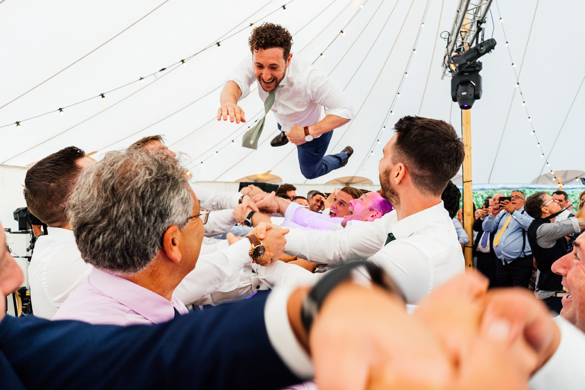 Groom in the air during the jewish dancing