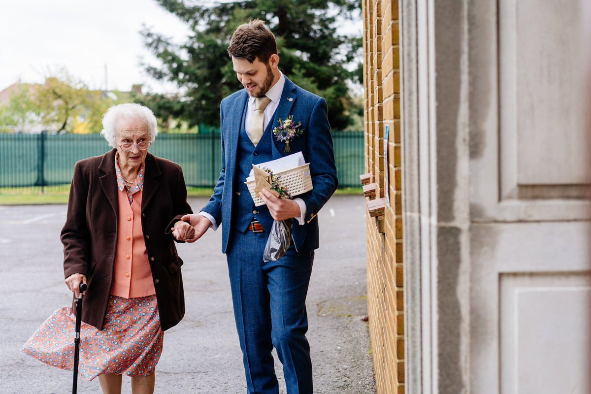 Groom helps his nan to the church entrance