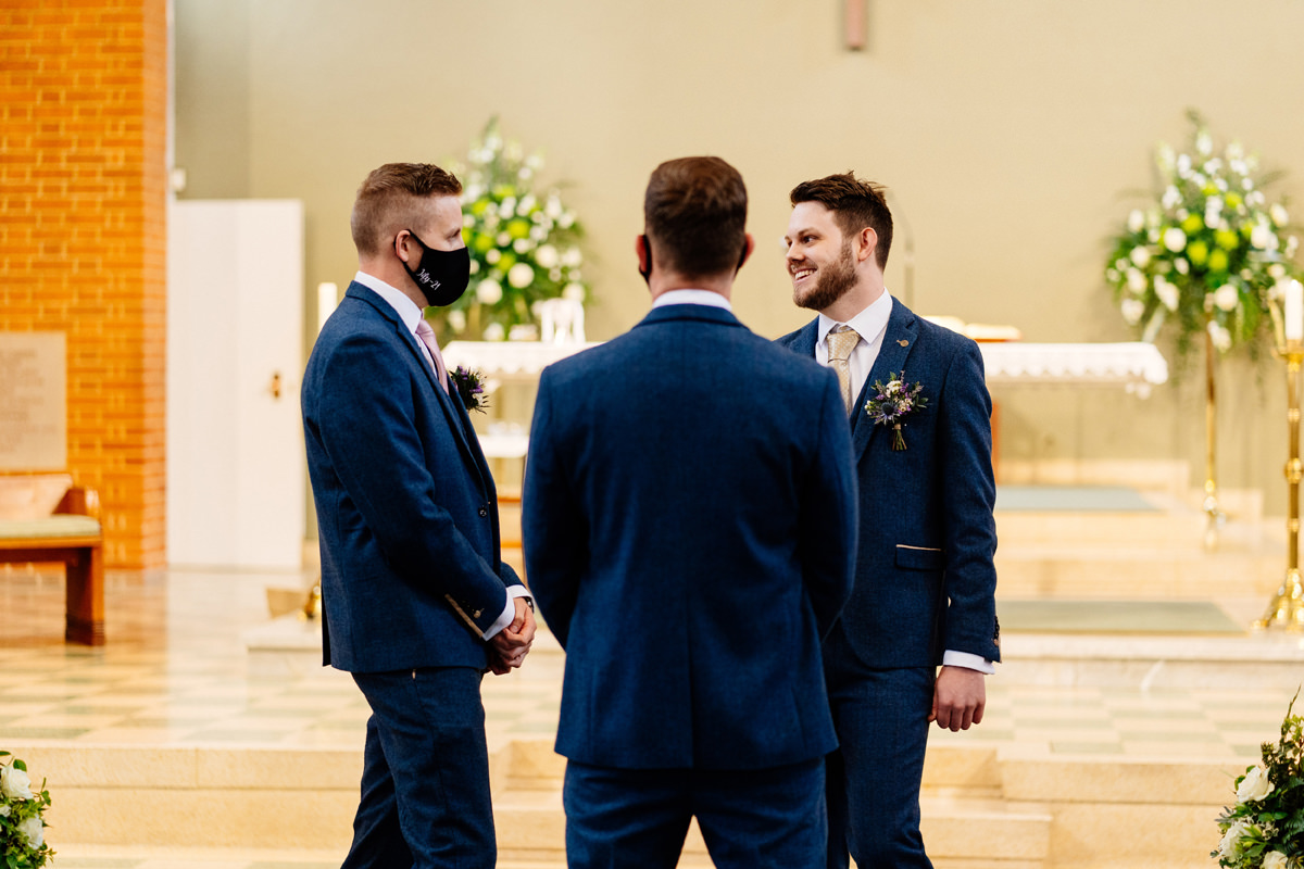 groom and groomsmen awaiting the arrival of the bride at the church