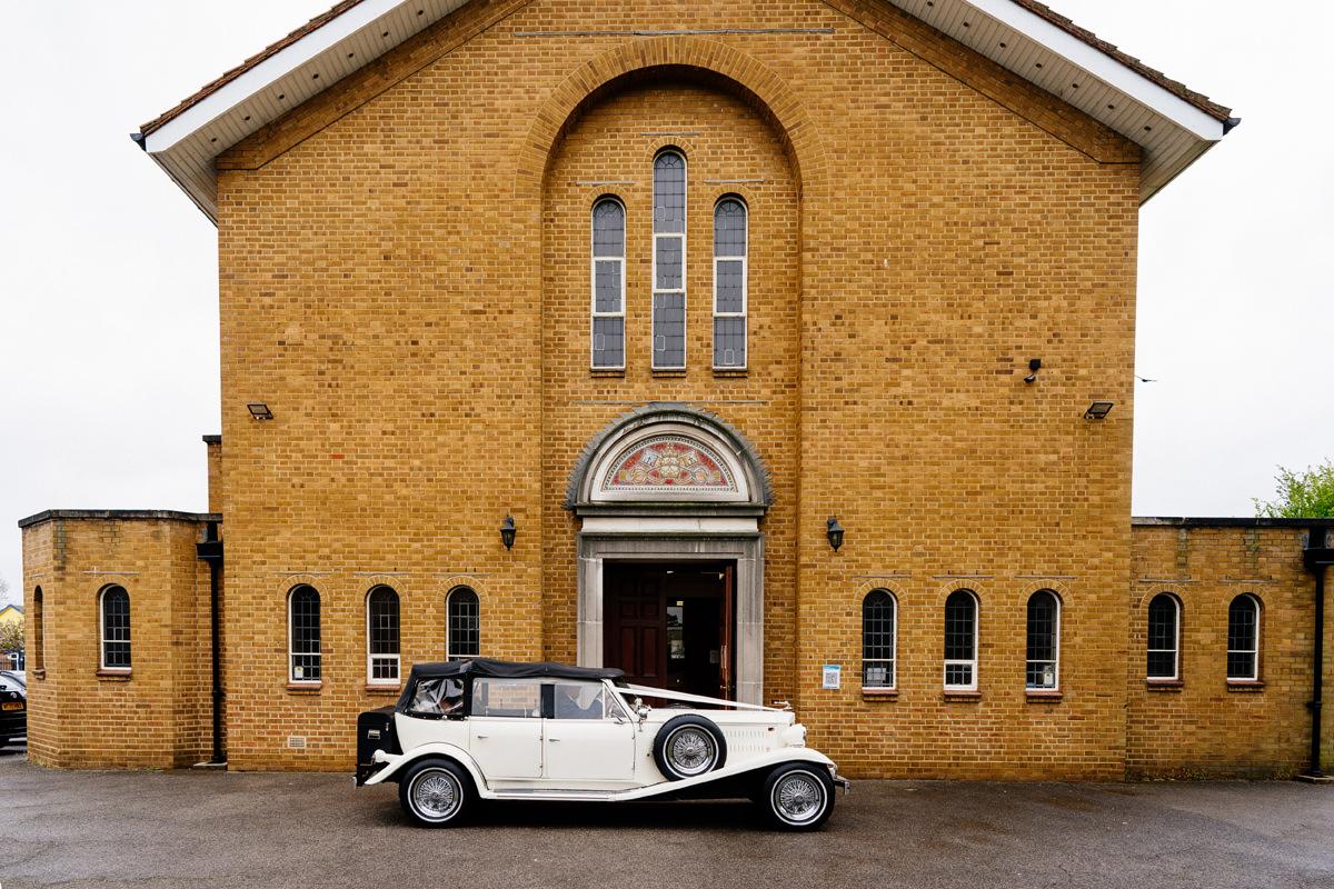 wedding car arrives outside the church
