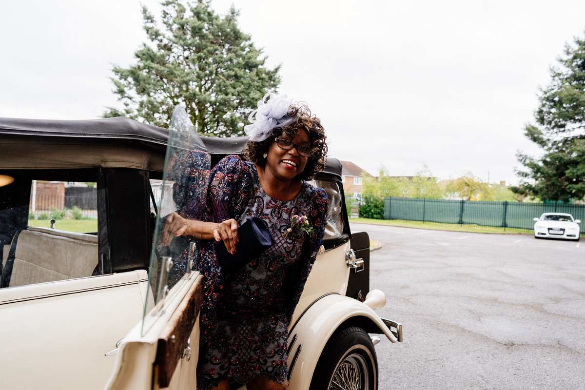 mother of the bride exits the wedding car