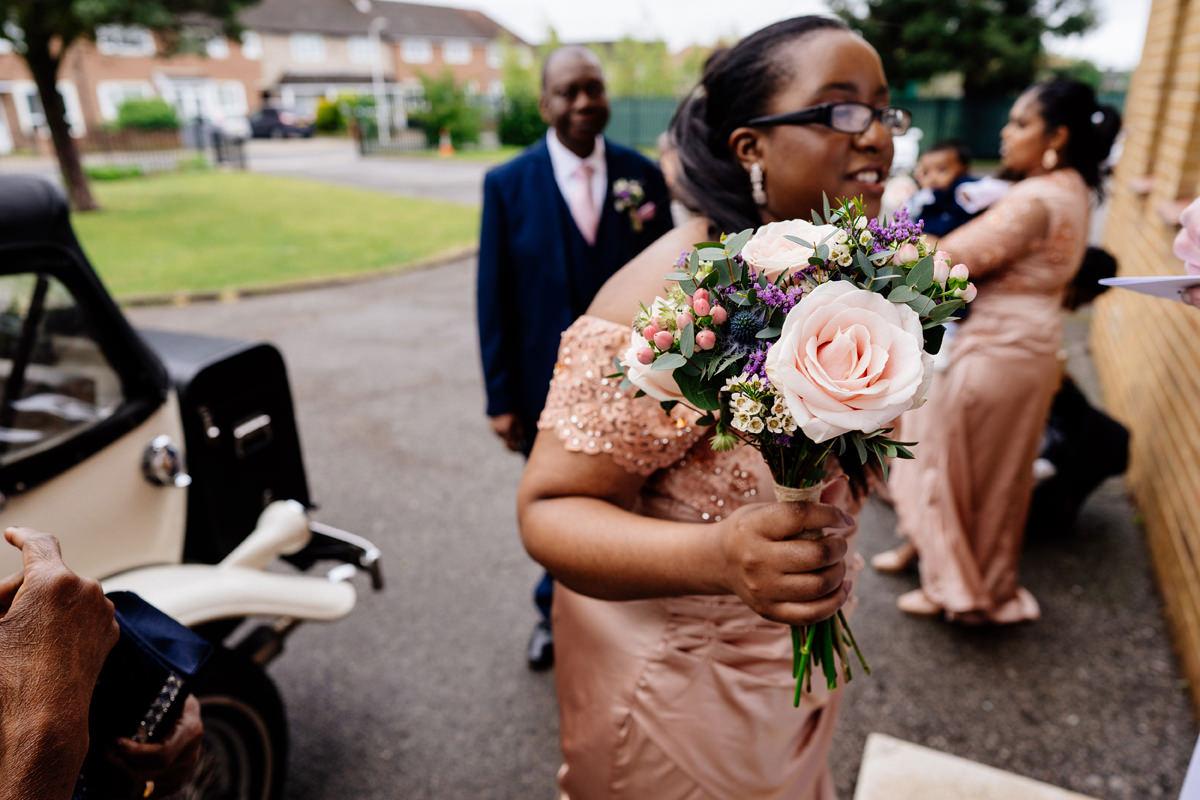 wedding bouquet held by bridesmaid