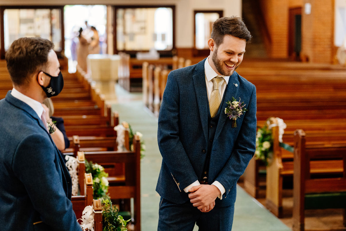 groom in the church awaiting the arrival of bridal party