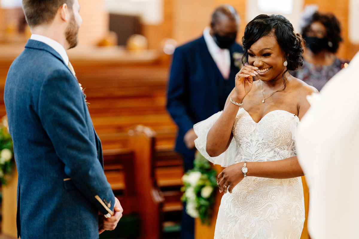 bride giggling during the marriage ceremony