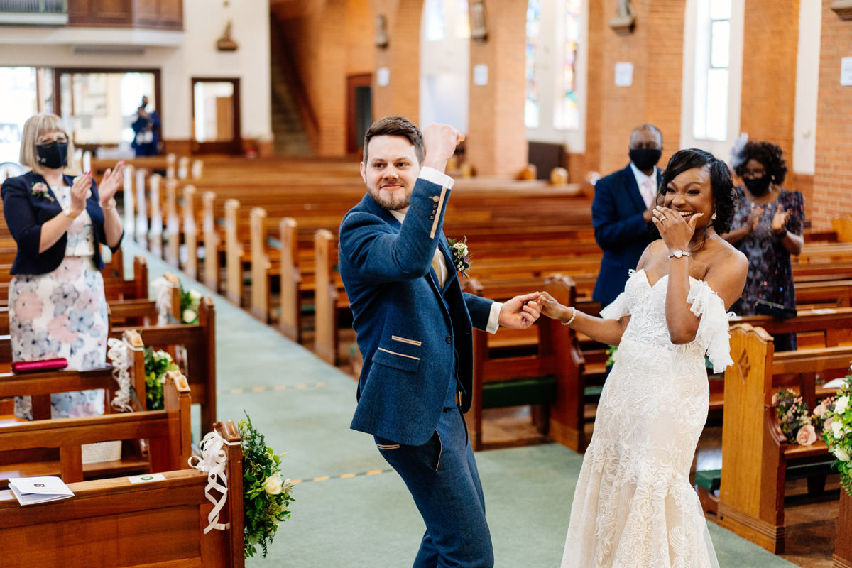 groom punching the air after being announced they are husband and wife