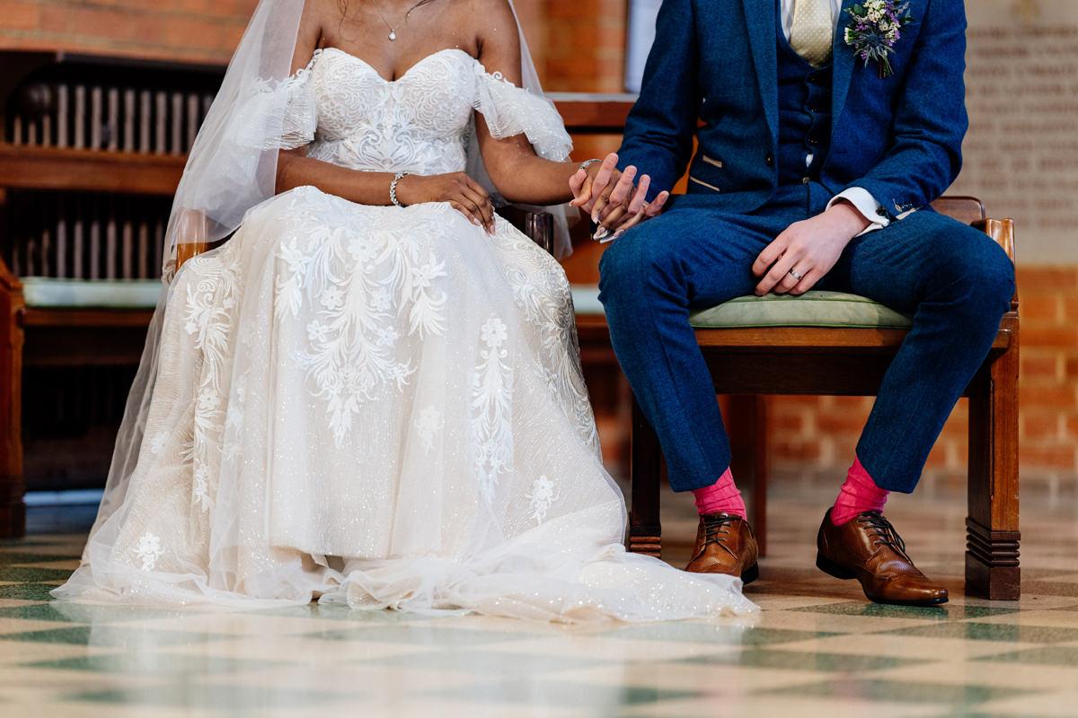 wedding dress details and groom's pink socks