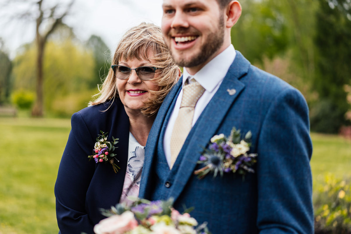 mother of groom smiling with her son