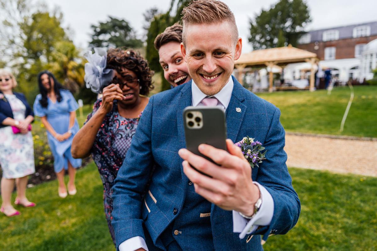 best man and groom take a selfie