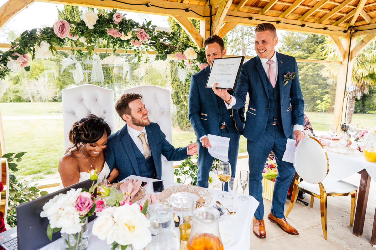 best men present the couple with a certificate of marriage