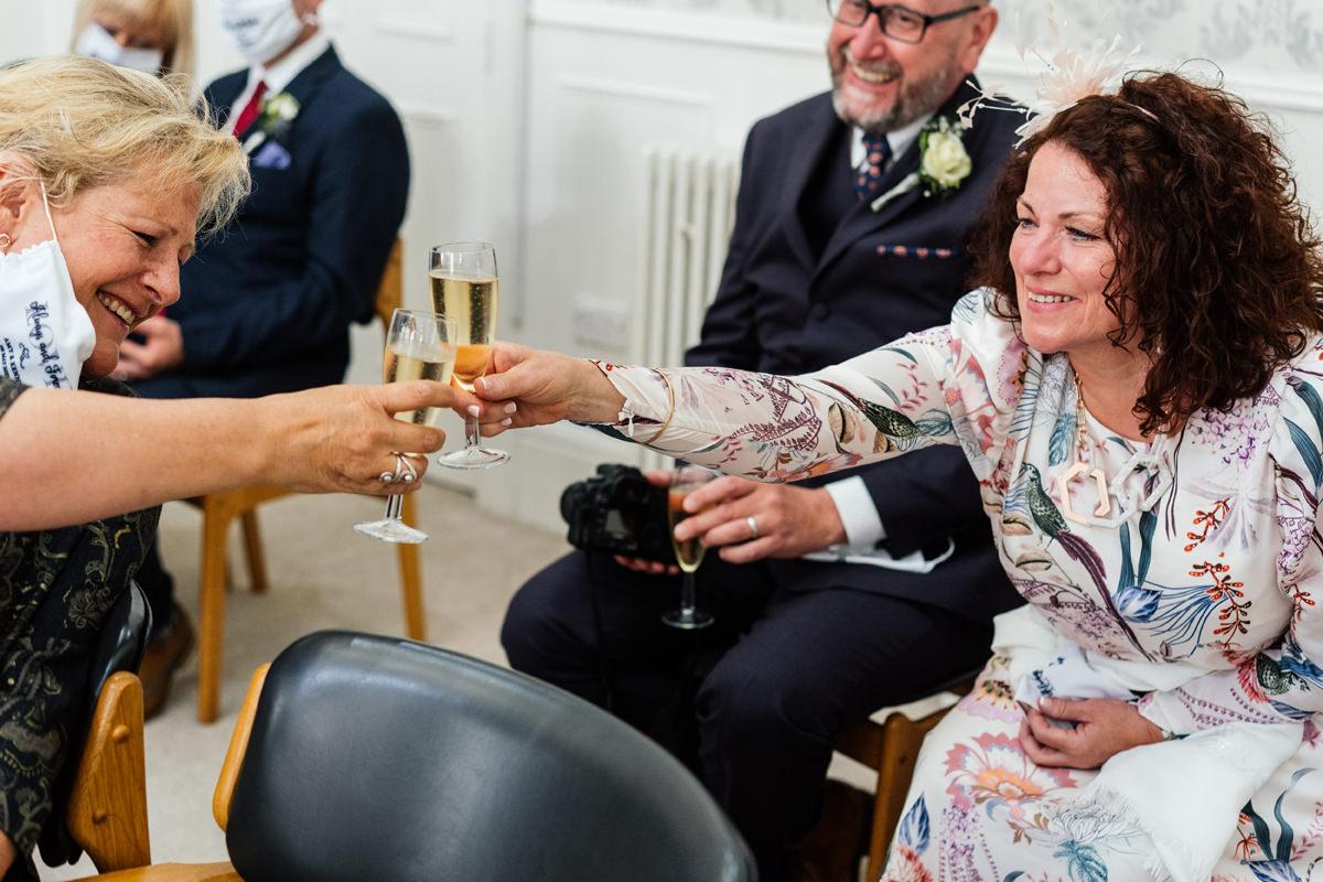 wedding guests having drinks