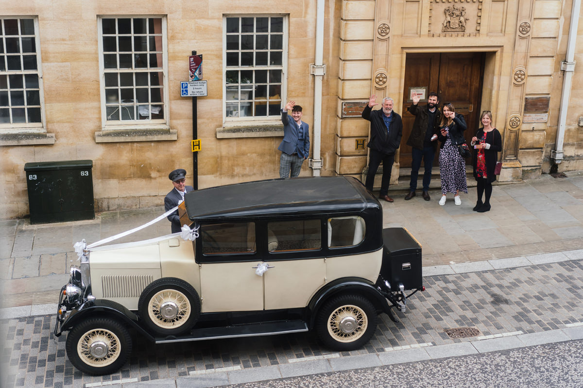 wedding car and onlookers outside