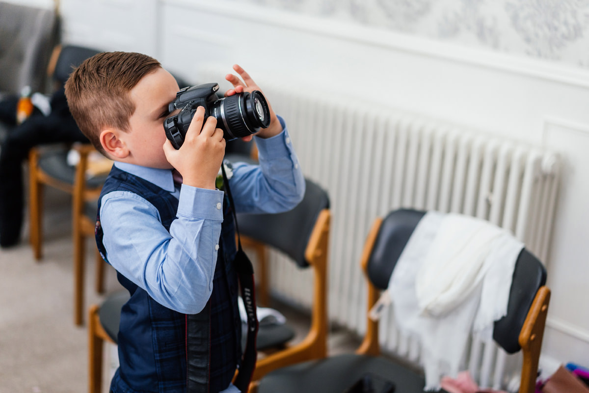 ring bearer takes a photo